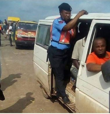 Nigerian police woman becomes bus conductor because of bribe