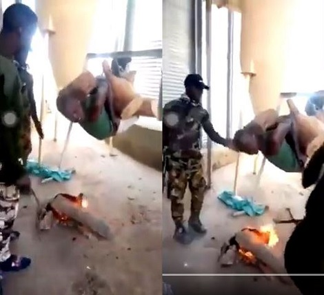Soldiers seen hanging suspect above fire to 'roast'