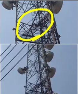man on power mast