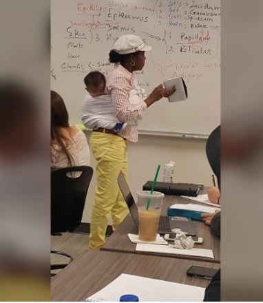 Georgia professor holds baby