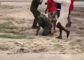Soldier getting the beating of his life in Warri