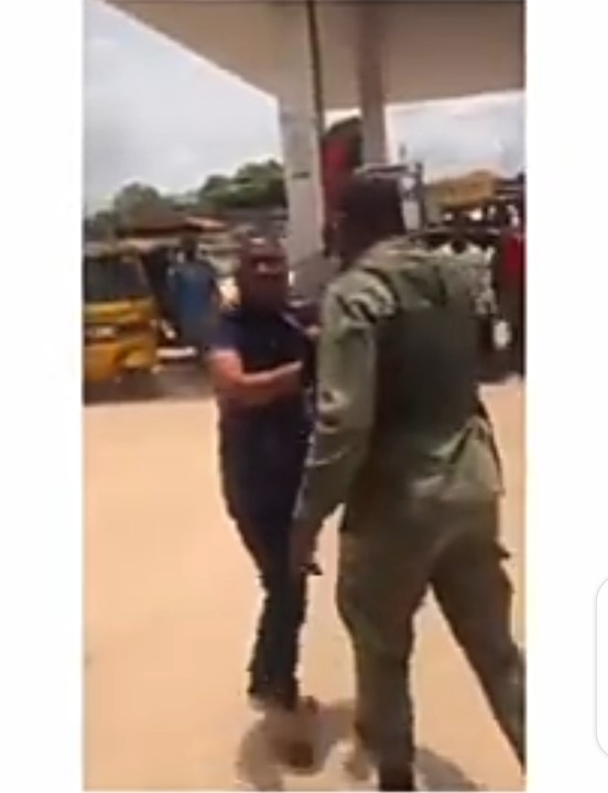 The soldier dragging the police officer during the altercation