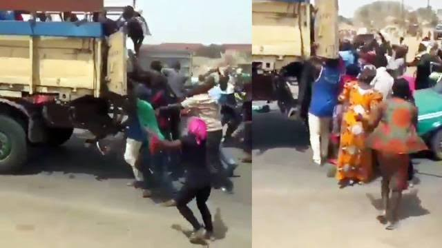 Abuja residents stealing rice from a truck