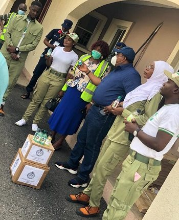 Corps members donate hand sanitizer and other disinfectant materials to Kwara government