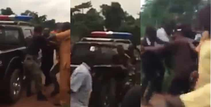 Police officers fighting in Edo