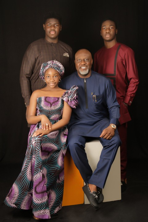 Dino Melaye posing with his family members