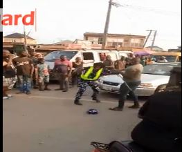 The soldier beating the policewoman in public