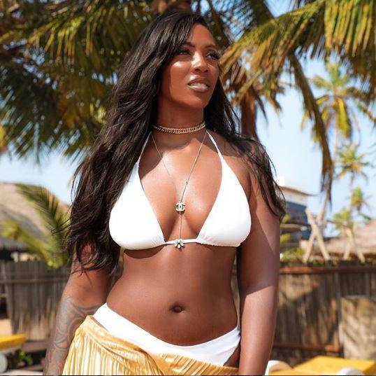 Tiwa Savage posing in a white bikini