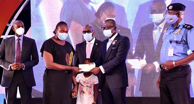 Sanwo-Olu presenting checks to families of the late officers