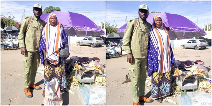 The NYSC member and the corn seller pose for a photo