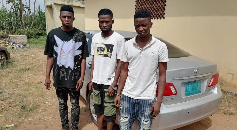 The three suspects after they were arrested by the police