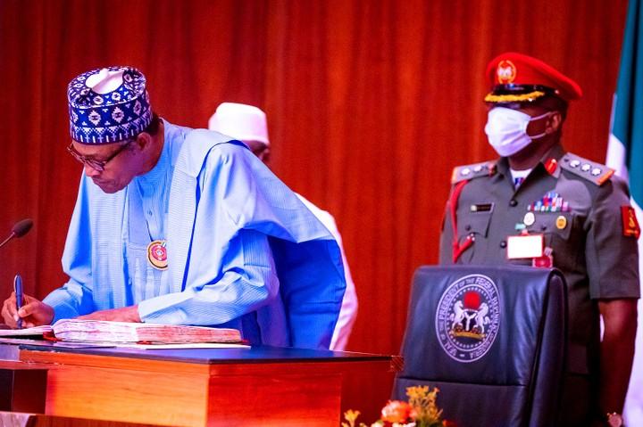 Yakubu Mamood sworn-in by President Buhari for a second term