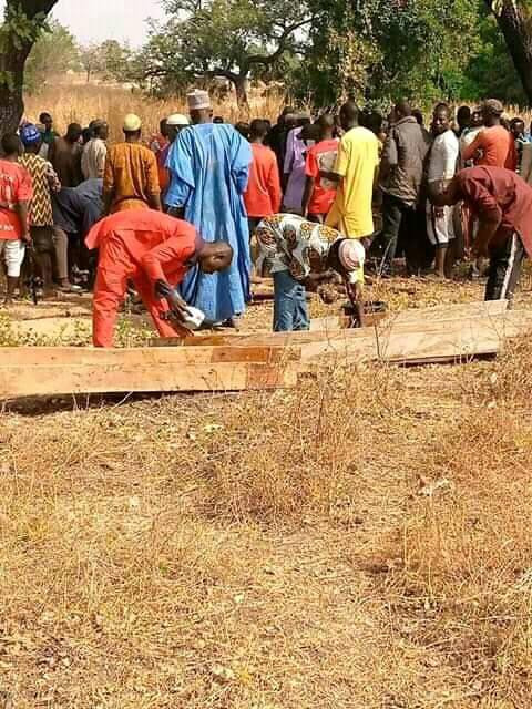 Isyaku and his son being buried after attack by bandits