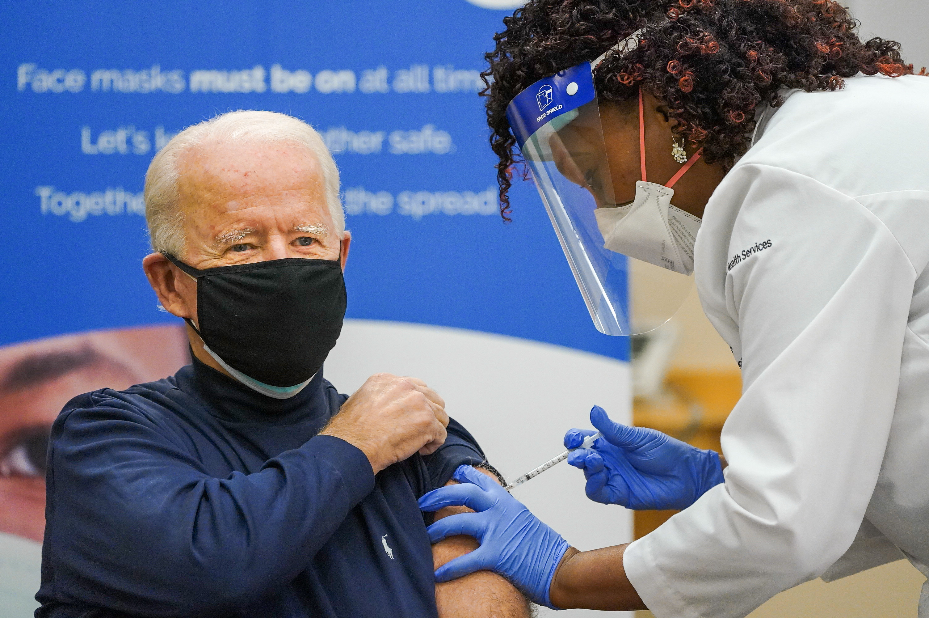 Joe Biden takes covid-19 vaccine live on television