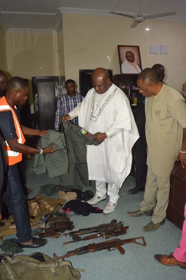 OPM founder, Apostle Chibuzor Gift Chinyere shows off the weapons recovered by the church from notorious armed roober