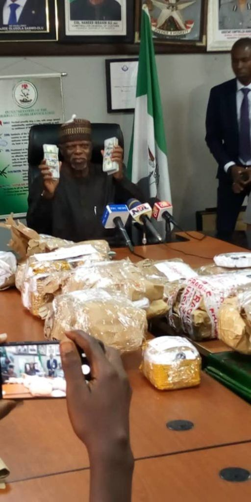 Customs Boss, Hameed Ali shows off dollars seized by his officers