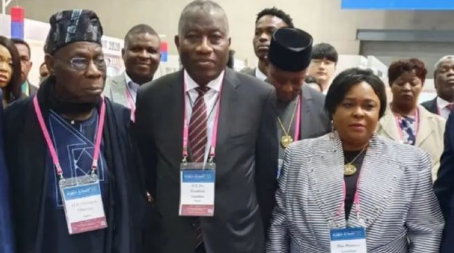 Olusegun Obasanjo posing with Goodluck Jonathan and his wife, Patience in Seoul, South Korea