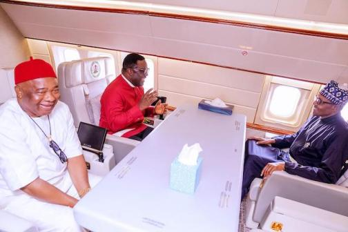 Buhari, Ayade and Hope Uzodinma inside the presidential jet