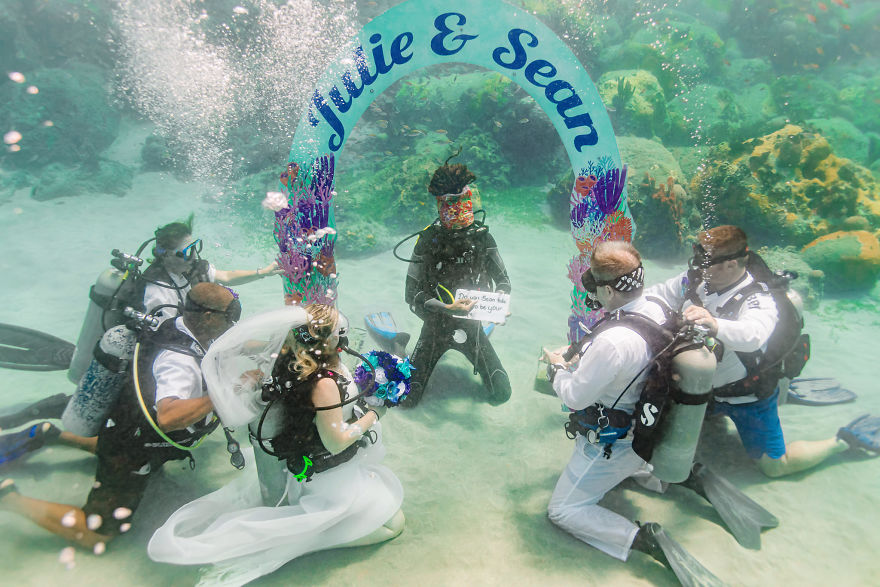 Julie and husband Sean tie the knot underwater