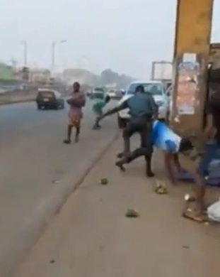Anambra Task Force officials assaulting a trader