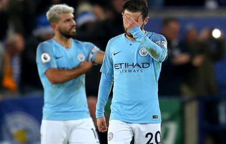 Two Manchester City players, Aguero and Silva