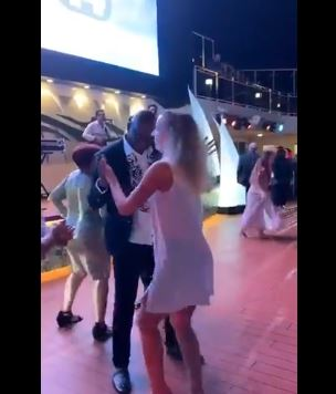 Ayodele Fayose dancing with a white woman abroad