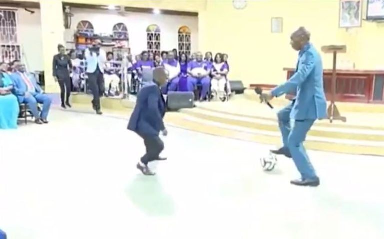 Pastor performing deliverance on church members with football