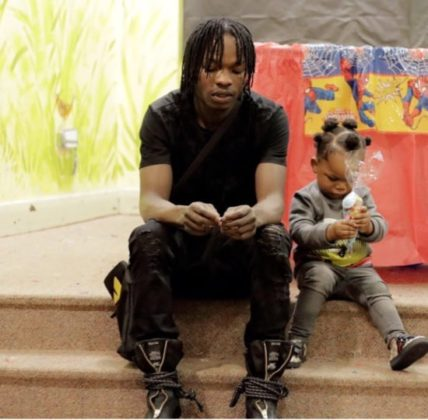 Naira Marley and son Jojo when he was still small