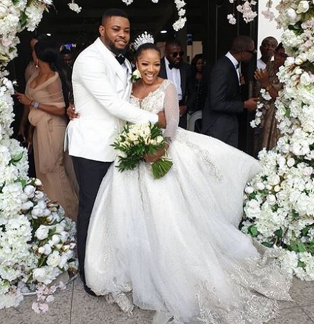 Sandra Ikeji and hubby on wedding day