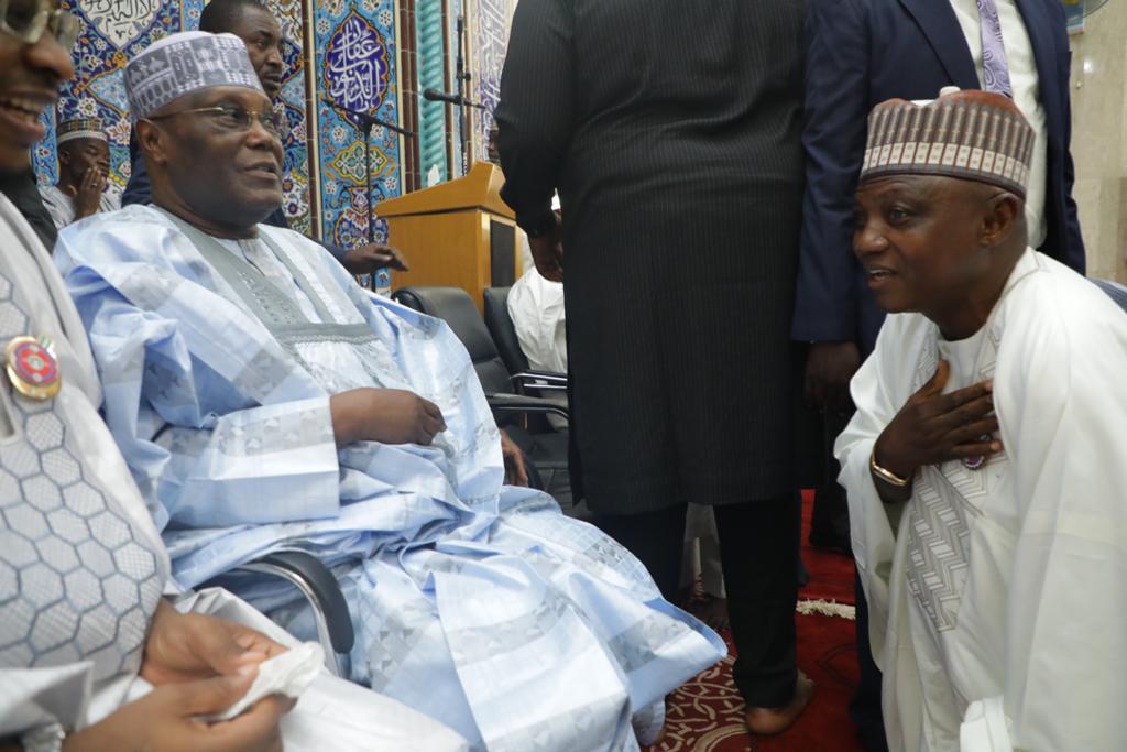 Garba Shehu kneeling for Atiku Abubakar