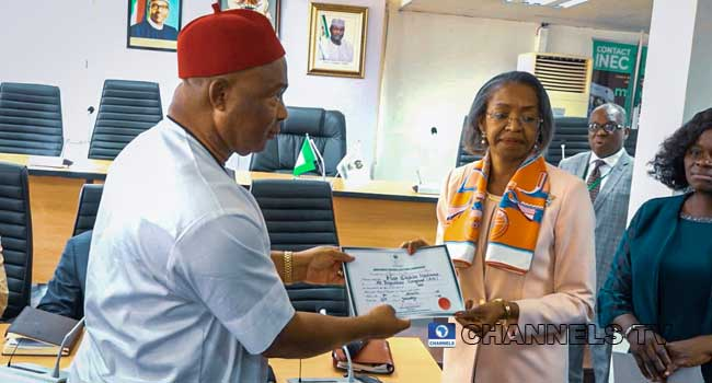 Hope Uzodinma receiving certificate of return from INEC