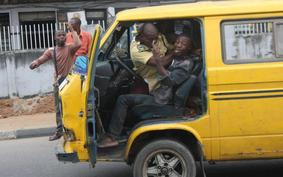 A Lastma official dragging steering wheel with a driver
