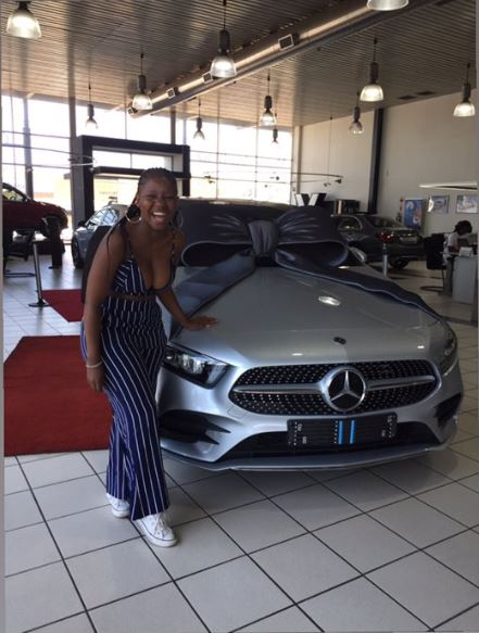 The lady shows off the car her mother gave her as a gift