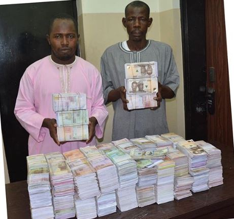 The arrested fraudsters with the fake notes