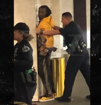 Offset being arrested at a shopping centre