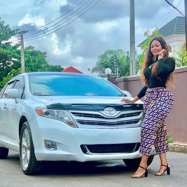 Crystal Okoye poses with her car