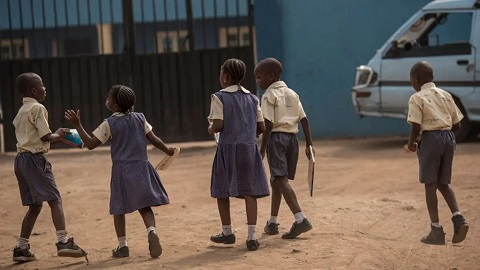 School children returning to school (file photo)