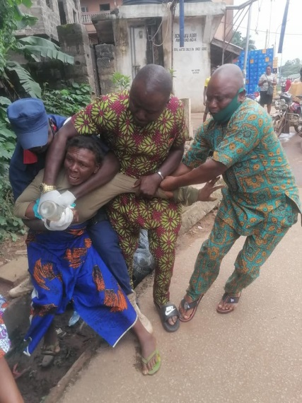 The woman resisted being taken out of the streets with her son