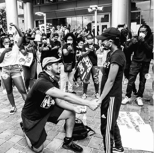 Xavier Young proposing to his girlfriend