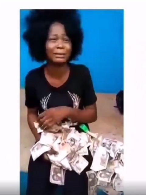 She was caught trying to deposit fake currency