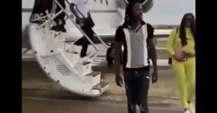 Naira Marley arriving Abuja via the jet
