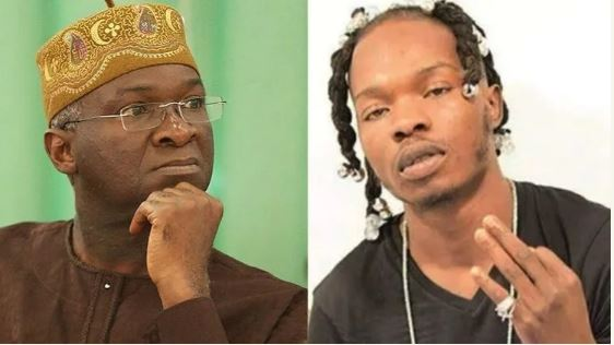 Minister of Works and Housing Babatunde Fashola and musician, Naira Marley