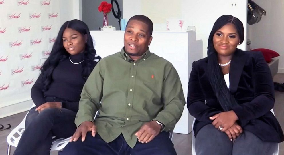 Kenneth Wimberly, center, poses with his daughters, Ashley Thomas, left, and Latoya WImberly.