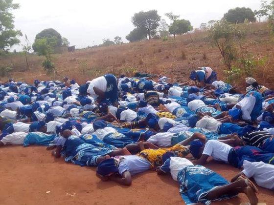 Women on the floor praying against coronavirus