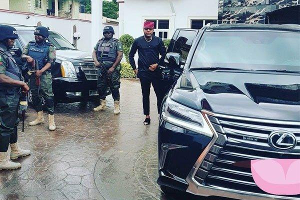 E-money and his police escorts