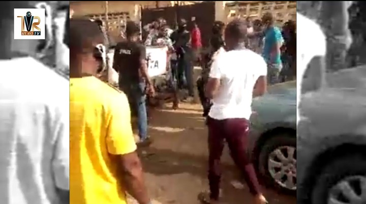 Police officers dragging man inside car for not wearing mask in Abuja