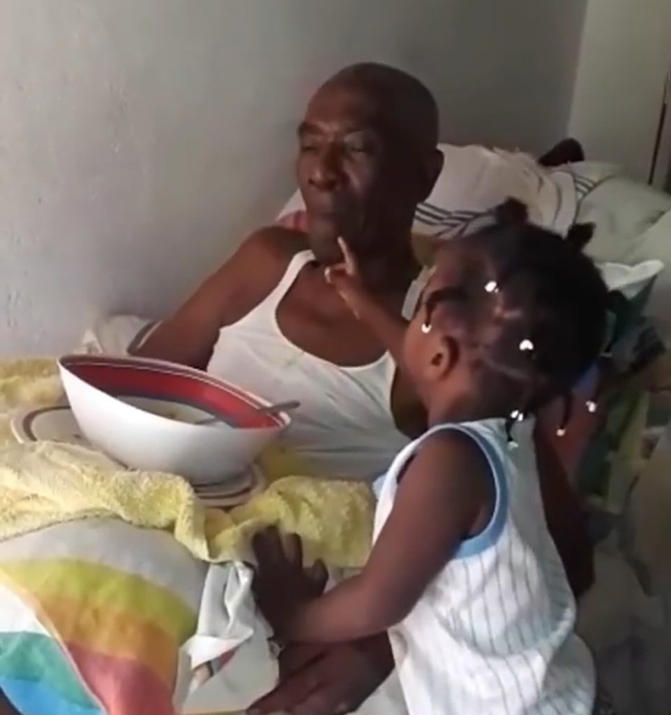 Touching photo of little girl helping grandfather who suffered stroke