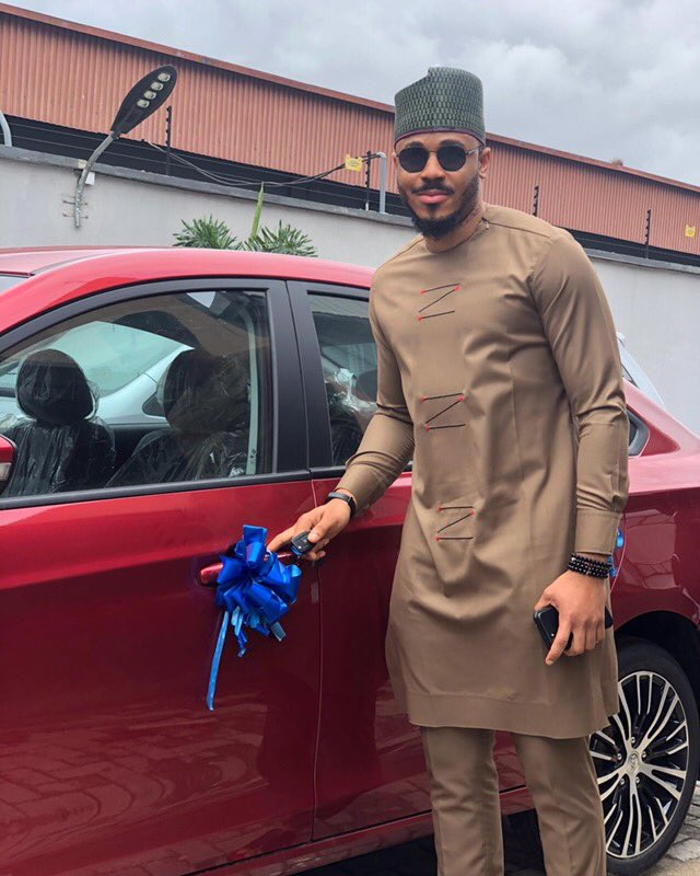 Ozo poses with his brand new car