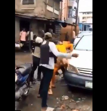 SARS operatives beating a motorist