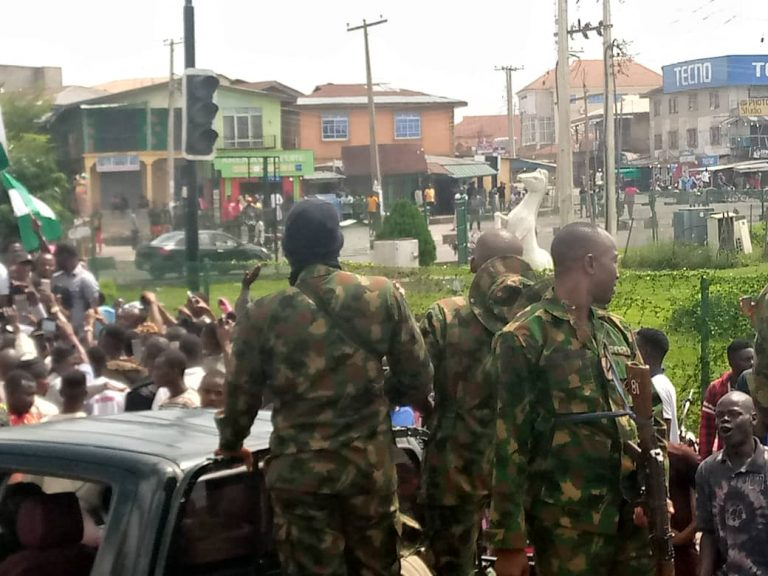 Soldier seen calming protesters down in Osogbo
